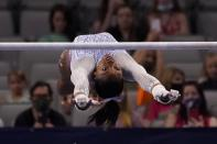 Simone Biles competes on the uneven bars during the U.S. Gymnastics Championships, Friday, June 4, 2021, in Fort Worth, Texas. (AP Photo/Tony Gutierrez)