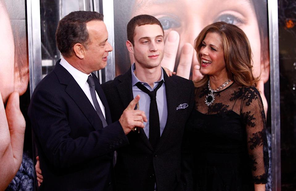 """Tom Hanks and Rita Wilson with their son Chet Hanks at the premiere of """"Extremely Loud & Incredibly Close"""" in 2011."""