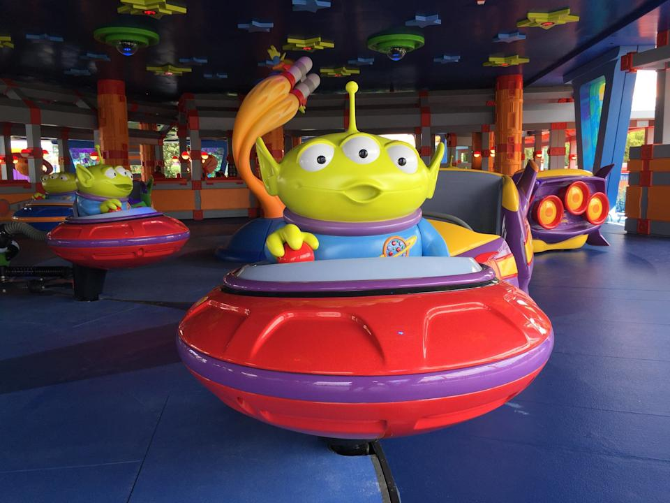 The Pizza Planet aliens from Toy Story take guests out for a spin.
