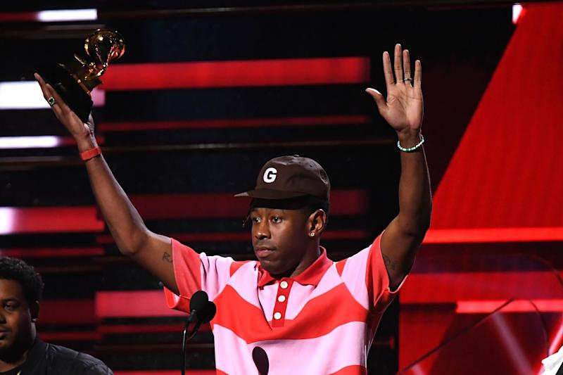 Tyler, the Creator with his Grammy for Best Rap Album: AFP via Getty Images