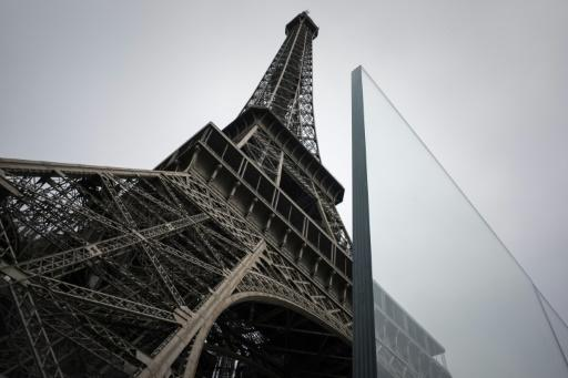 The new glass walls around the Eiffel Tower are part of security measures that have cost nearly 35 million euros