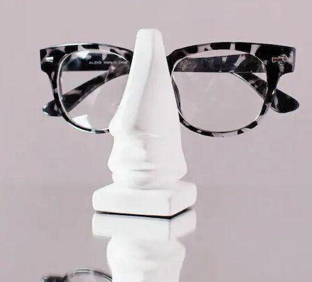 "<a href=""https://www.linenchest.com/en/leon-nose-eyeglass-holder.html"" target=""_blank"">Leon eyeglasses holder, $14.95, Linen Chest</a>"