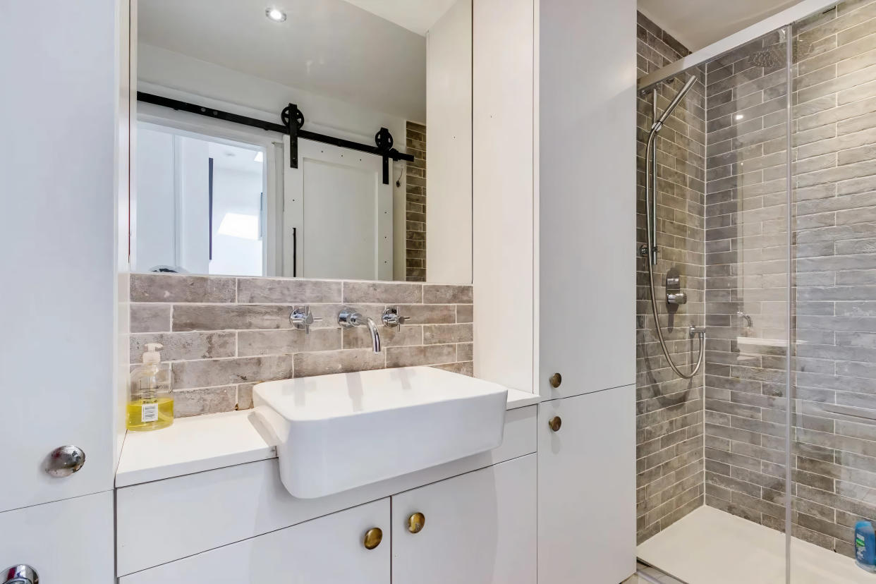 The renovated bathroom has a sliding door to save space. (Zoopla)