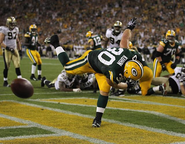 GREEN BAY, WI - SEPTEMBER 08: John Kuhn #30 of the Green Bay Packers spikes the ball after scoring a touchdown against the New Orleans Saints during the NFL opening season game at Lambeau Field on September 8, 2011 in Green Bay, Wisconsin. (Photo by Jonathan Daniel/Getty Images)