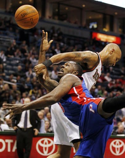Detroit Pistons' Rodney Stuckey, left, is fouled by Milwaukee Bucks' Drew Gooden, right, during the first half of an NBA basketball game, Thursday, Jan. 12, 2012, in Milwaukee. (AP Photo/Jeffrey Phelps)