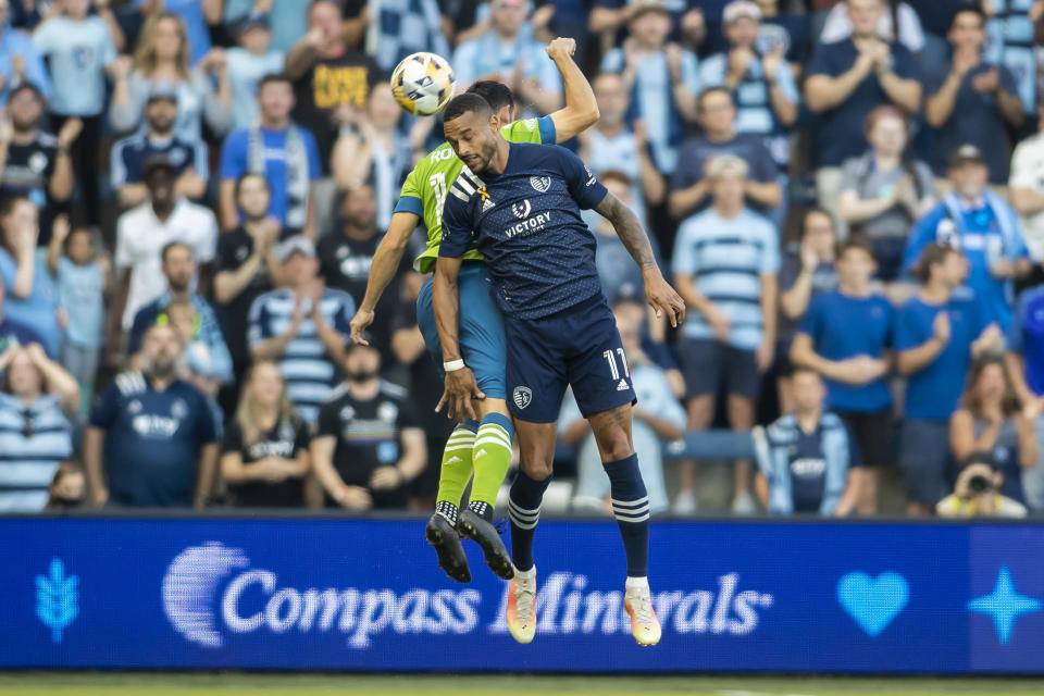 Sporting Kansas City forward Khiry Shelton goes up for a header during the first half of an MLS soccer match against the Seattle Sounders, Sunday, Sept. 26, 2021, in Kansas City, Kan. (AP Photo/Nick Tre. Smith)