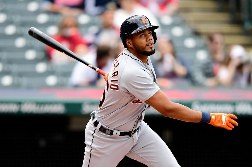 Jeimer Candelario of the Detroit Tigers hits an RBI single in the first inning during a game against the Cleveland Indians at Progressive Field on April 11, 2021, in Cleveland, Ohio.