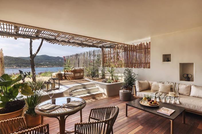 """<p>Ibiza's latest luxury hotel opening is all about creating sustainable five-star experiences while connecting visitors to local culture. Eco-friendly architecture and extensive wellness programming that stretches beyond the one-of-a-kind spa to the arts, adventure, and more, a trip to <a href=""""https://www.sixsenses.com/en/resorts/ibiza"""" rel=""""nofollow noopener"""" target=""""_blank"""" data-ylk=""""slk:Six Senses Ibiza"""" class=""""link rapid-noclick-resp"""">Six Senses Ibiza</a> is sure to leave guests enlightened, rejuvenated, and inspired. Plus, the sweeping Xarraca Bay views from this 20-acre property don't hurt either. </p><p> <em>Six Senses Ibiza opened in July 2021. Nightly rates start at approximately $890 in hot season and $460 in cool season.</em></p>"""