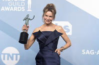 """Renee Zellweger poses in the press room with the award for outstanding performance by a female actor in a leading role for """"Judy"""" at the 26th annual Screen Actors Guild Awards at the Shrine Auditorium & Expo Hall on Sunday, Jan. 19, 2020, in Los Angeles. (Photo by Jordan Strauss/Invision/AP)"""