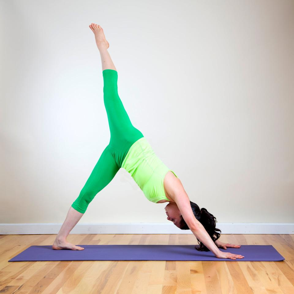 """<ul> <li>Begin in <a href=""""https://www.popsugar.com/fitness/Downward-Facing-Dog-2671016"""" class=""""ga-track"""" data-ga-category=""""Related"""" data-ga-label=""""http://www.popsugar.com/fitness/Downward-Facing-Dog-2671016"""" data-ga-action=""""In-Line Links"""">Downward Facing Dog</a>. Step both feet together so your big toes are touching.</li> <li>Shift weight into your hands and your left foot equally. Raise your right leg up to the ceiling. Try to keep your shoulders parallel with the ground, and gaze at your left thigh or up toward your belly to help you stay balanced. To feel the stretch in your left hamstring, try to keep pressing your left heel down toward the ground.</li> <li>Stay here for five breaths (about 30 seconds).</li> </ul>"""