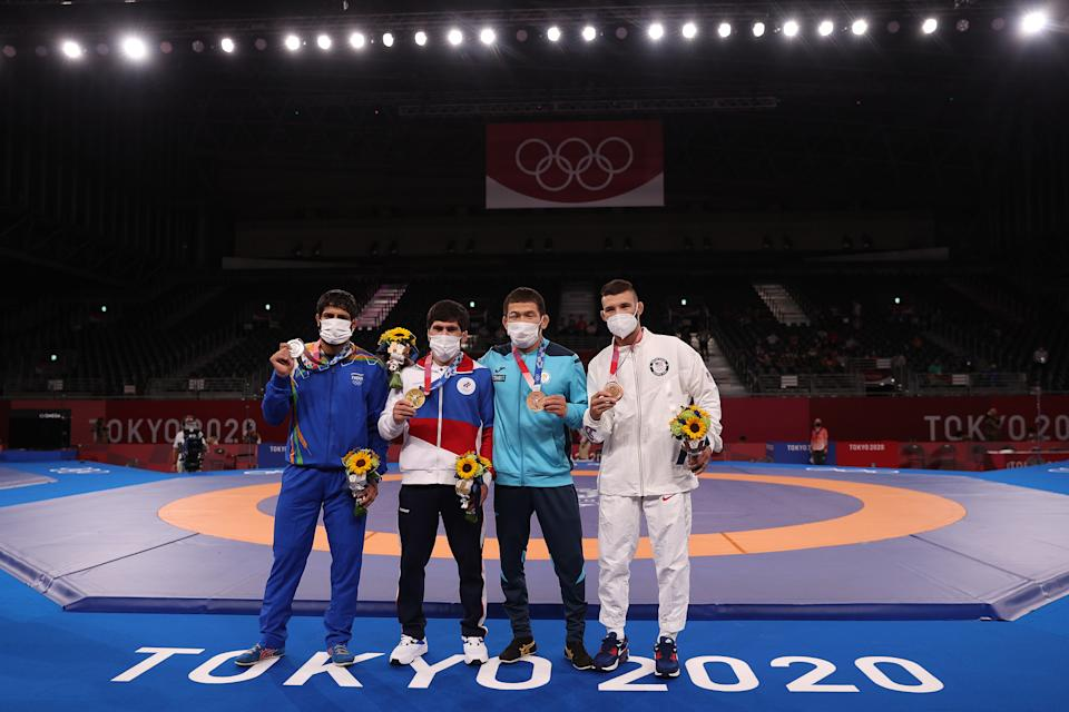 CHIBA, JAPAN - AUGUST 05: Men's Freestyle 57kg medalists (L-R); silver medalist Kumar Ravi of Team India, gold medalist Zavur Uguev of Team ROC, bronze medalist Nurislam Sanayev of Team Kazakhstan and second bronze medalist Thomas Patrick Gilman pose with their medals during the Victory Ceremony on day thirteen of the Tokyo 2020 Olympic Games at Makuhari Messe Hall on August 05, 2021 in Chiba, Japan. (Photo by Maddie Meyer/Getty Images)