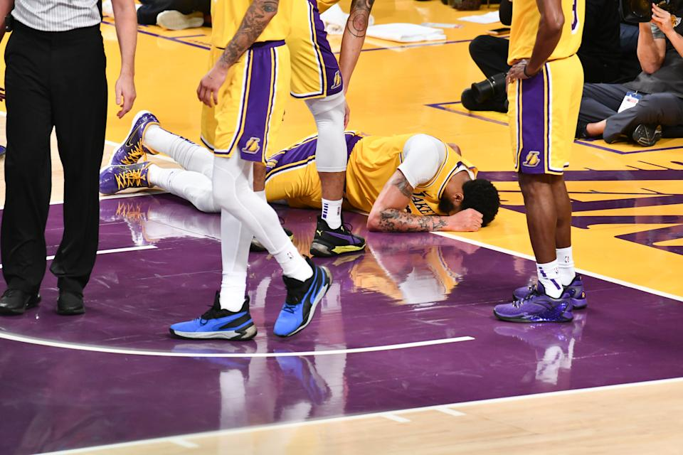 LOS ANGELES, CALIFORNIA - JANUARY 07: Anthony Davis #3 of the Los Angeles Lakers gets injured after taking a hard fall on his tail bone during the third quarter of a game against the New York Knicks at Staples Center on January 07, 2020 in Los Angeles, California. NOTE TO USER: User expressly acknowledges and agrees that, by downloading and/or using this photograph, user is consenting to the terms and conditions of the Getty Images License Agreement.  (Photo by Allen Berezovsky/Getty Images,)