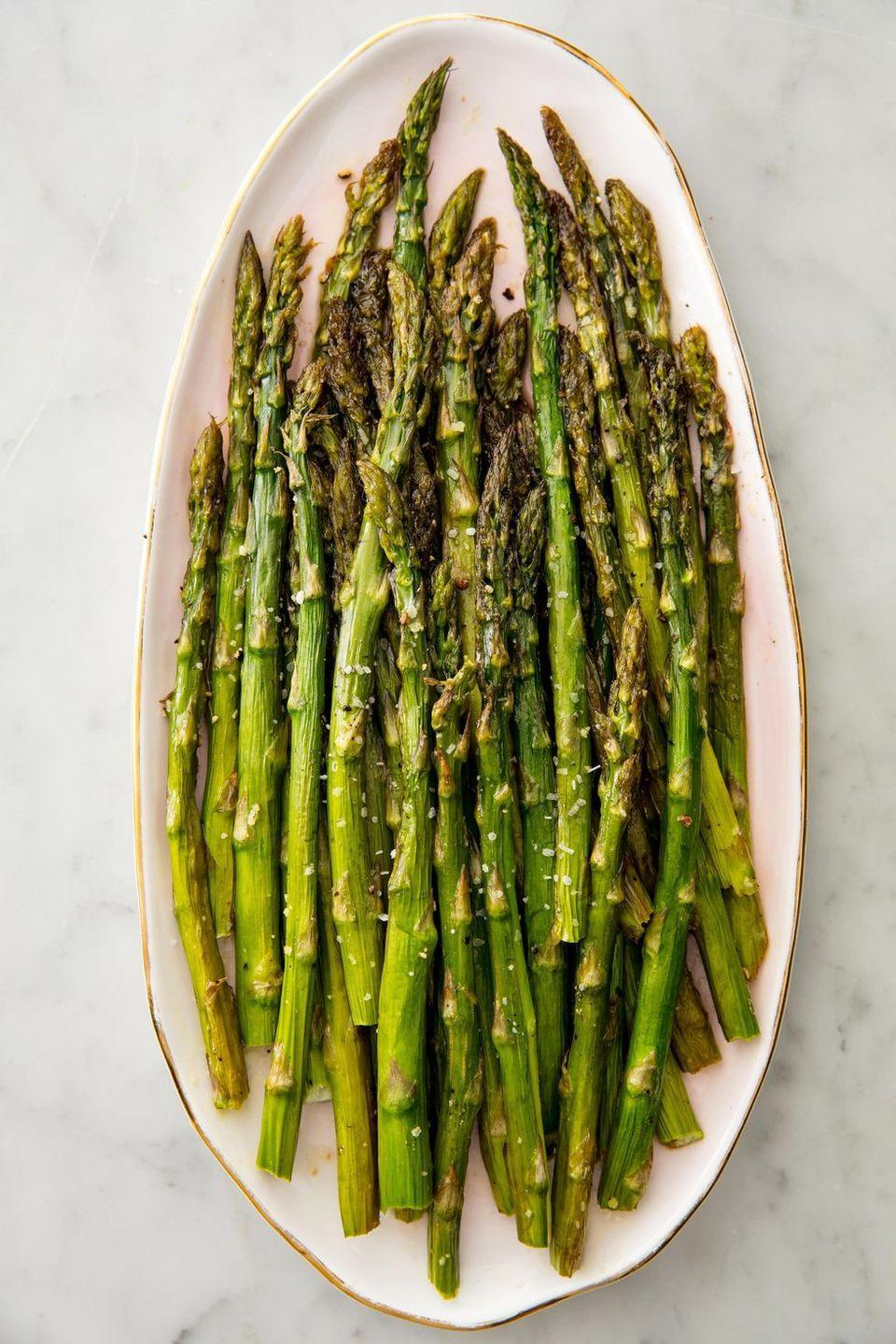 """<p>There are many ways you can <a href=""""https://www.delish.com/uk/cooking/a29557777/cook-asparagus/"""" rel=""""nofollow noopener"""" target=""""_blank"""" data-ylk=""""slk:cook asparagus"""" class=""""link rapid-noclick-resp"""">cook asparagus</a>, but roasting is our absolute favourite. When the stalks darken and crisp, they're not burning, they're developing more flavour.</p><p>Get the <a href=""""https://www.delish.com/uk/cooking/recipes/a31219635/oven-roasted-asparagus-recipe/"""" rel=""""nofollow noopener"""" target=""""_blank"""" data-ylk=""""slk:Roasted Asparagus"""" class=""""link rapid-noclick-resp"""">Roasted Asparagus</a> recipe.</p>"""