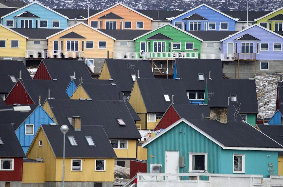 <p>Uniform houses stray from the norm with colorful exteriors that complement one another.</p>
