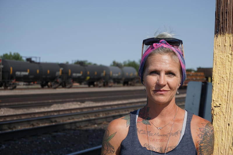 In this Thursday, Sept. 5, 2019 photo Blackjewel warehouse technician Melissa Worden, poses for a photo in Gillette, Wyo. The shutdown of Blackjewel LLC's Belle Ayr and Eagle Butte mines in Wyoming since July 1, 2019 has added yet more uncertainty to the Powder River Basin's struggling coal economy. (AP Photo/Mead Gruver)