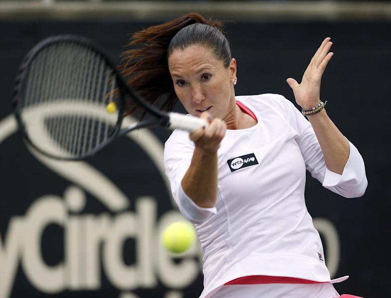 Jelena Jankovic, of Serbia, returns to Jessica Pegula, during the Family Circle Cup tennis tournament in Charleston, S.C., Thursday, April 4, 2013. (AP Photo/Mic Smith)