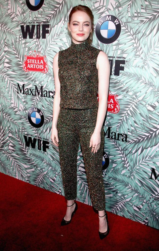 <p>Emma Stone is cool and relaxed in Prada (Photo: Getty Images) </p>