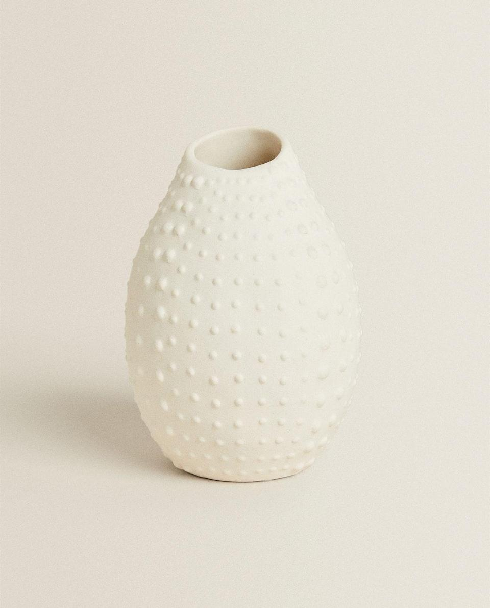 "<p>zarahome.com</p><p><strong>$19.90</strong></p><p><a href=""https://www.zarahome.com/us/living-room/vases/textured-vase-c1020264606p302069592.html?colorId=250&ct=true"" rel=""nofollow noopener"" target=""_blank"" data-ylk=""slk:Shop Now"" class=""link rapid-noclick-resp"">Shop Now</a></p><p>For a minimal approach, try a monochrome hobnail vase. Its organic form reminds us of Kusama's signature dotted pumpkins and gourds. </p>"