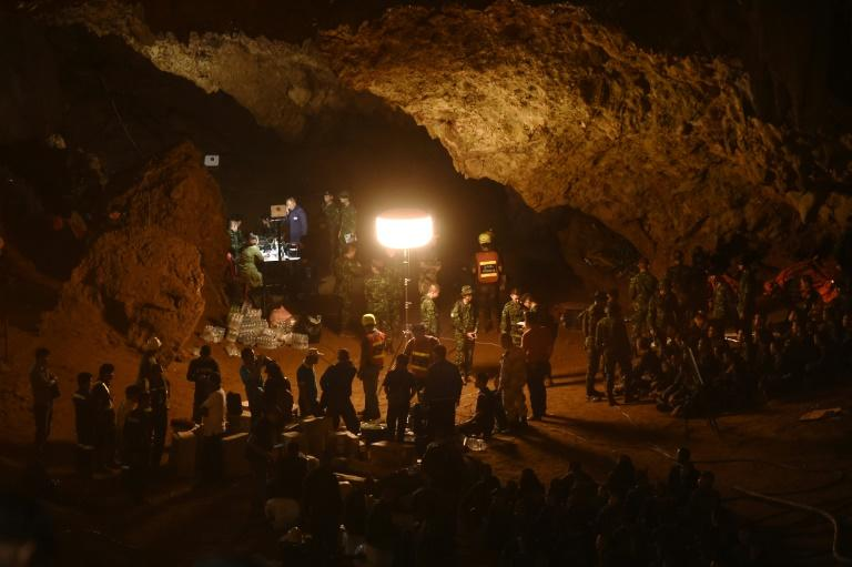 Soldiers work at the Tham Luang cave in Chiang Rai, Thailand on June 26, 2018 during the rescue operation for the trapped youth soccer team and their coach