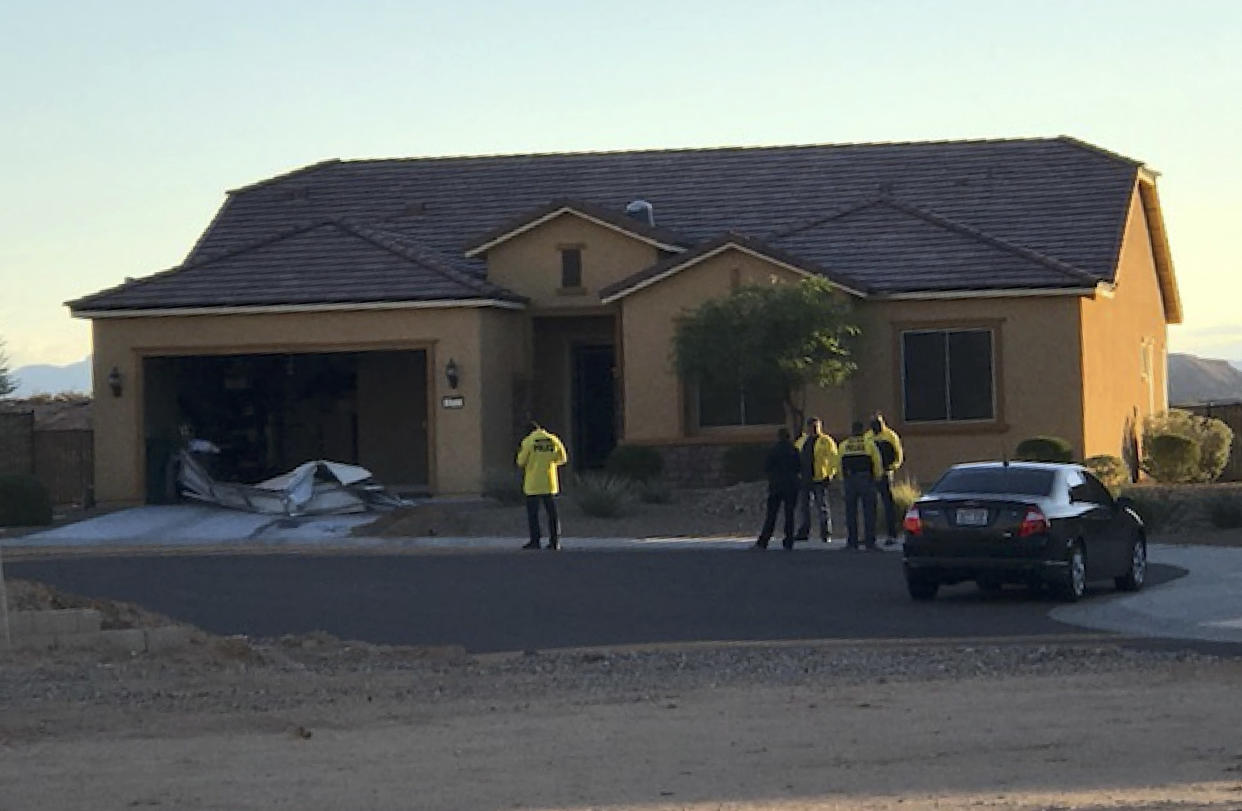 Police personnel stand outside the home of Stephen Paddock in Mesquite, Nev., Oct. 2, 2017. (Photo: Mesquite Police via AP)