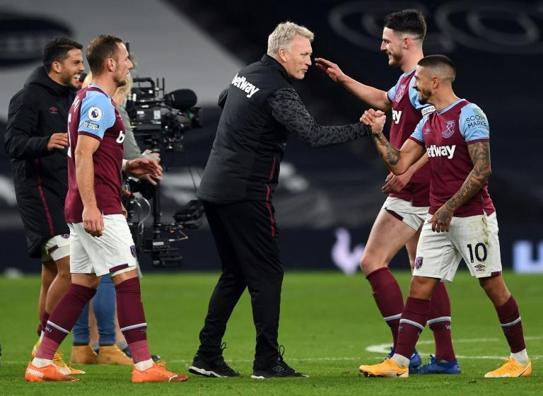 West Ham manager David Moyes (centre) celebrates coming from 3-0 down to draw 3-3 at Tottenham