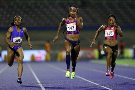 Athletics - JAAA National Senior Championships - National Stadium Kingston, Jamaica - June 23, 2017 Jamaica's Jura Levy (L-R), Elaine Thompson, and Christania Williams in action during the Women's 100m final REUTERS/Lucy Nicholson