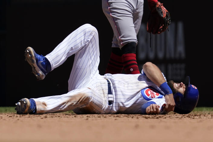 Chicago Cubs' David Bote reacts after an injury during the fourth inning of a baseball game against the Cincinnati Reds in Chicago, Saturday, May 29, 2021. (AP Photo/Nam Y. Huh)