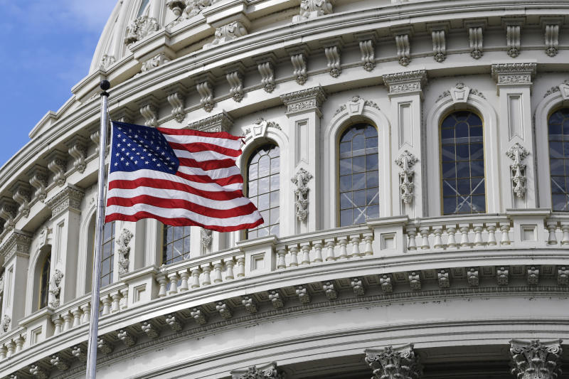 The American flag flies on Capitol Hill in Washington, Tuesday, March 17, 2020. (AP Photo/Susan Walsh)