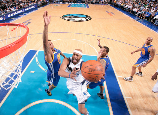 DALLAS, TX - APRIL 20: Vince Carter #25 of the Dallas Mavericks goes in for the lay up against Brandon Rush #4 of the Golden State Warriors on April 20, 2012 at the American Airlines Center in Dallas, Texas. (Photo by Glenn James/NBAE via Getty Images)