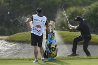 Phil Mickelson works out a bunker on the 12th hole during the third round at the PGA Championship golf tournament on the Ocean Course, Saturday, May 22, 2021, in Kiawah Island, S.C. (AP Photo/Matt York)