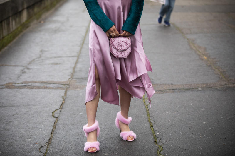 PARIS, FRANCE - MARCH 03: Jaime Xie, wearing, purple silk skirt and pink fur heels, is seen outside Valentino on Day 7 Paris Fashion Week Autumn/Winter 2019/20 on March 3, 2019 in Paris, France. (Photo by Claudio Lavenia/Getty Images)