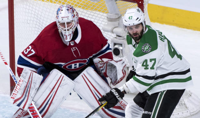 Dallas Stars right wing Alexander Radulov (47) keeps close to Montreal Canadiens goaltender Antti Niemi (37) during the first period of an NHL hockey game, Tuesday, March 13, 2018, in Montreal. (Paul Chiasson/The Canadian Press via AP)