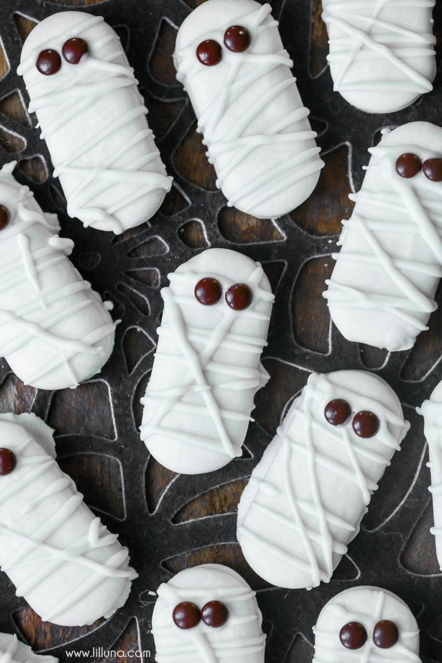 """<p>Looking for a little treat to make with the littles ones? These three-ingredient mummies are a great option.</p><p><strong>Get the recipe at <a href=""""https://lilluna.com/mummy-cookies/"""" rel=""""nofollow noopener"""" target=""""_blank"""" data-ylk=""""slk:Lil' Luna"""" class=""""link rapid-noclick-resp"""">Lil' Luna</a>.</strong> </p>"""