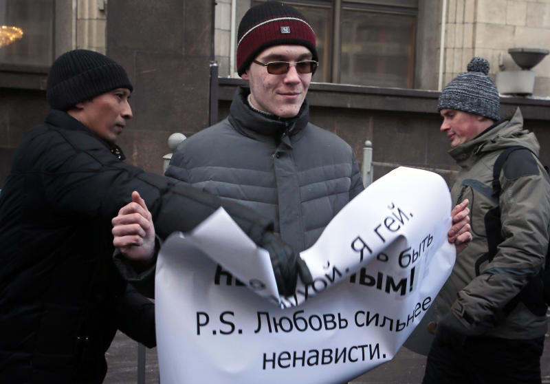 "A supporter of a bill banning "" homosexual propaganda"" tries to grab a poster  from the hands of a gay rights activist, during a protest near the State Duma, Russia's lower parliament chamber, in Moscow, Russia, Friday, Jan. 25, 2013. A controversial bill banning ""homosexual propaganda"" has been submitted to Russia's lower house of parliament for the first of three hearings on Friday, Jan. 25, 2013. The poster reads: I'm Blind and I'm Gay and I Refuse to be Invisible. P.S. Love is Stronger Then Hate.  (AP Photo/Mikhail Metzel)"