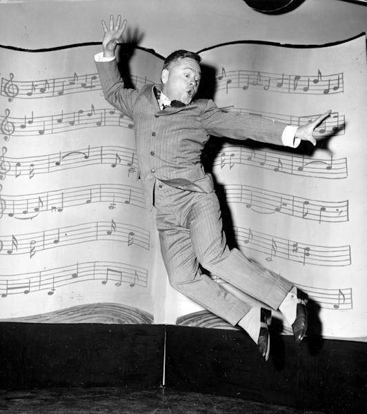 """FILE - In this March 19, 1957, file photo, actor, singer and dancer Mickey Rooney, wearing spats and a pinstriped suit, performs a dance routine during rehearsal for the television show """"George M. Cohan Story"""" in Hollywood, Calif. Rooney, a Hollywood legend whose career spanned more than 80 years, has died. He was 93. Los Angeles Police Commander Andrew Smith said that Rooney was with his family when he died Sunday, April 6, 2014, at his North Hollywood home. (AP Photo/File)"""