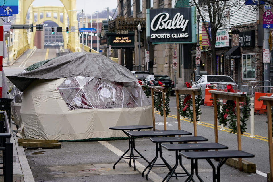 Kiosks for outdoor dining are situated in front of restaurants along Sixth St. in downtown Pittsburgh, Sunday, Jan. 17, 2021. (AP Photo/Keith Srakocic)
