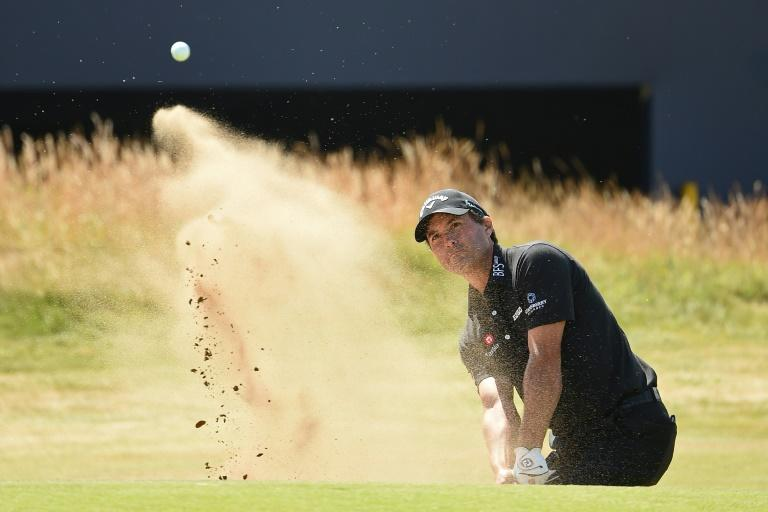 Kevin Kisner plays out of a green-side bunker on the 18th hole during his first-round 66 on the opening day at Carnoustie