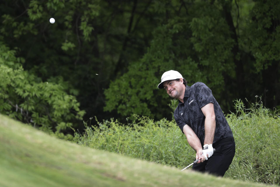 Keegan Bradley chips to the green on the first hole during round-robin play at the Dell Technologies Match Play Championship golf tournament, Friday, March 29, 2019, in Austin, Texas. (AP Photo/Eric Gay)