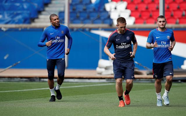 Soccer Football - Ligue 1 - Paris St Germain Training - Ooredoo Training Centre, Saint-Germain-en-Laye, France - May 16, 2018 Paris Saint-Germain's Kylian Mbappe and Marco Verratti during training REUTERS/Benoit Tessier