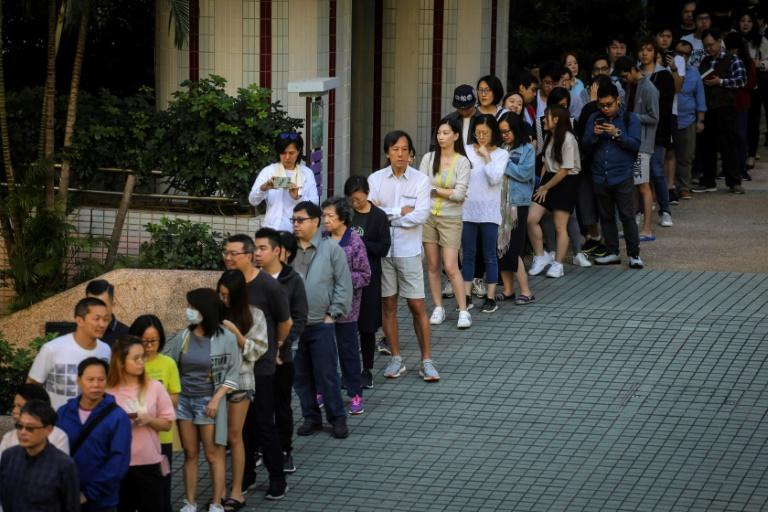 Voters line up to cast their ballot in Hong Kong's district council elections