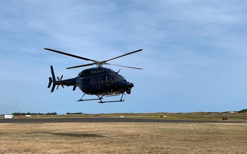 A New Zealand Police helicopter returns to Whakatane Airport after conducting a search for bodies in the aftermath of the eruption of White Island volcano, which is also known by its Maori name Whakaari, December 15, 2019 - via REUTERS