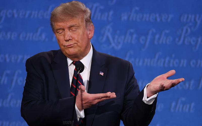 U.S. President Donald Trump participates in the first presidential debate against Democratic presidential nominee Joe Biden at the Health Education Campus of Case Western Reserve University on September 29, 2020 in Cleveland, Ohio. This is the first of three planned debates between the two candidates in the lead up to the election on November 3 - GETTY IMAGES