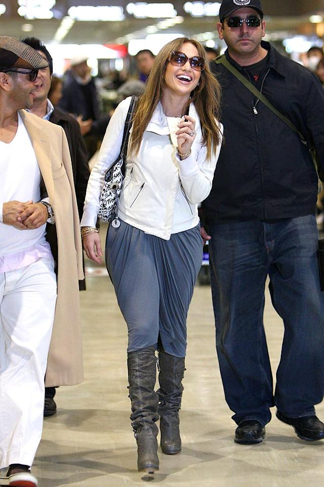 """J.Lo seems hampered by her MC Hammer-inspired parachute pants. Perhaps she should lose them like the rapper lost his career. <a href=""""http://www.splashnewsonline.com"""" target=""""new"""">Splash News</a> - March 27, 2009"""
