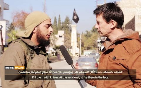 Salim Benghalem being interview by John Cantlie, a British journalist captured by Isil, on one of its propaganda channels - Credit: Hayat Media