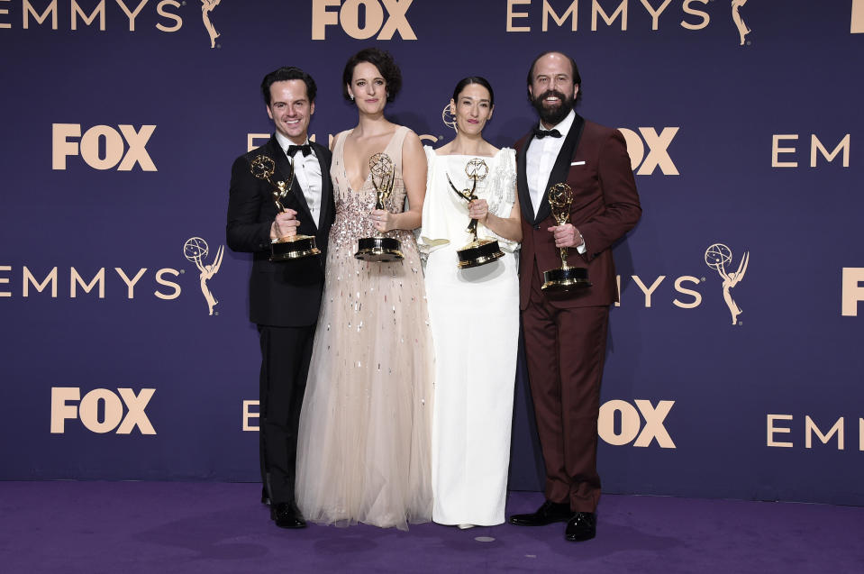"""Andrew Scott, from left, Phoebe Waller-Bridge, Sian Clifford, and Brett Gelman, winners of the award for outstanding comedy series for """"Fleabag,"""" pose in the press room at the 71st Primetime Emmy Awards on Sunday, Sept. 22, 2019, at the Microsoft Theater in Los Angeles. (Photo by Jordan Strauss/Invision/AP)"""