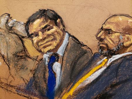 """Accused Mexican drug lord Joaquin """"El Chapo"""" Guzman and defense attorney A. Eduardo Balarezo, sit in court in this courtroom sketch during Guzman's trial in Brooklyn federal court in New York City, U.S., January 30, 2019.  REUTERS/Jane Rosenberg"""