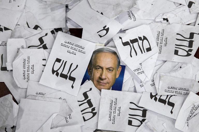 Copies of ballots papers and campaign posters for Israel's Prime Minister Benjamin Netanyahu's Likud Party lie on the ground after the country's parliamentary elections on March 18, 2015 in Tel Aviv