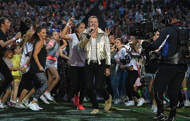 Macklemore's performance brought the crowd to their knees. Source: AAP