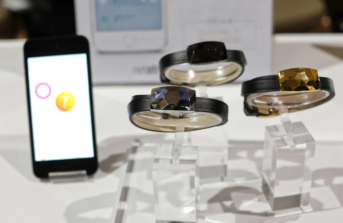 The June bracelet by Netatmo sits on display at the International Consumer Electronics Show, Sunday, Jan. 5, 2014, in Las Vegas. The jewel on the band connects with an iOS device and alerts the user when the skin has received too much sun exposure. (AP Photo/Julie Jacobson)