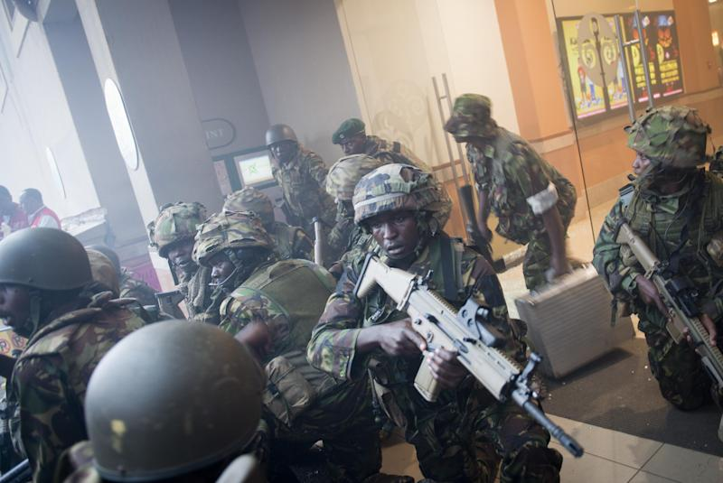 FILE - In this Saturday Sept. 21 2013 file photo, armed police leave after entering the Westgate Mall in Nairobi, Kenya Saturday, Sept. 21, 2013 after gunmen threw grenades and opened fire in a terrorist attack. The Sept. 21 terrorist attack on Nairobi's Westgate Mall produced a raft of questions that haven't always had clear, complete answers and the answers to some questions have changed over time - The Associated Press attempts to define what is known and not known about the deadly mall attack. (AP Photo/Jonathan Kalan, File)